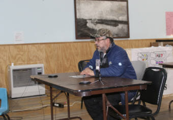 Nick Kameroff testifies at a public meeting and hearing in Aniak on January 17. State regulators traveled to Aniak, Bethel, and Anchorage to discuss permits for the Donlin Gold Mine. (Photo courtesy Dave Cannon)