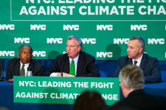 New York City Mayor Bill de Blasio, center, announced that the city is suing five major oil companies over climate change. The city also announced it will divest from companies owning fossil fuel reserves. (Photo courtesy of New York City Mayor's Office)