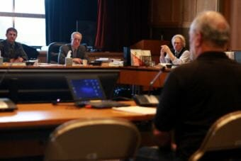 Board of Fisheries members Israel Payton (Wasilla), Alan Cain (Anchorage), and Fritz Johnson (Dillingham) hear testimony on shellfish proposals on the first day of the Southeast Shellfish/Finfish meeting in Sitka. (Photo by Robert Woolsey/KCAW)