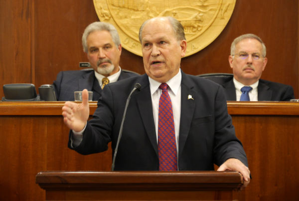 Independent Gov. Bill Walker addresses the Alaska Legislature on Jan. 18, 2018, in the Alaska State Capitol in Juneau. Senate President Pete Kelly, R-Fairbanks, and House Speaker Bryce Edgmon, D-Dillingham, are seated at the dais behind him. It was Walker's fourth State of the State Address. (Photo by Skip Gray/360 North)