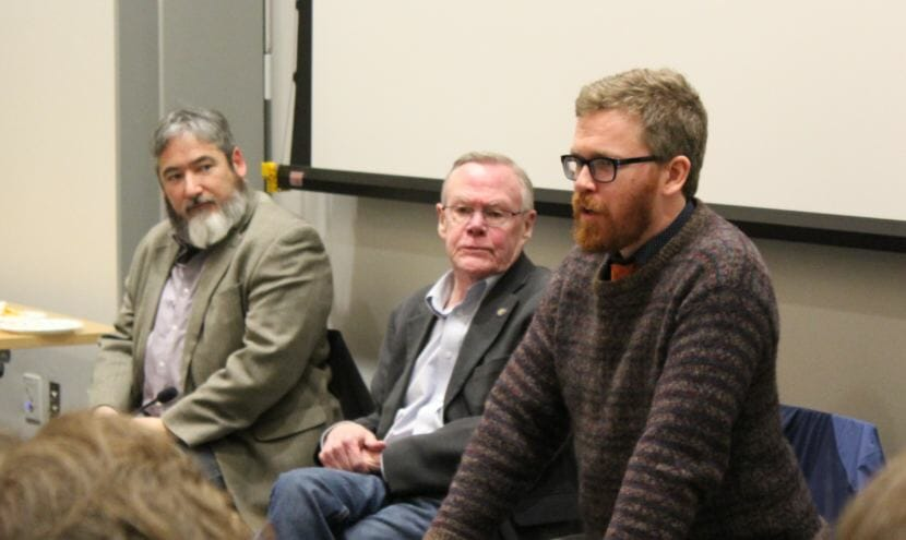 Rep. Justin Parish addresses a packed room at the Mendenhall Valley Public Library during a town hall with Juneau's state legislators on Thursday, Jan. 11, 2018. Parish, Rep. Sam Kito III, left, and Sen. Dennis Egan make up Juneau's legislative delegation. (Photo by Adelyn Baxter/KTOO)