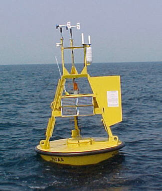 """National Data Buoy Center operated 3-meter discus buoy for taking weather and marine observations. (Creative Commons photo by < a href=""""https://commons.wikimedia.org/wiki/File:NOAA-NDBC-discus-buoy.jpg"""">JonathanLamb/Wikimedia"""