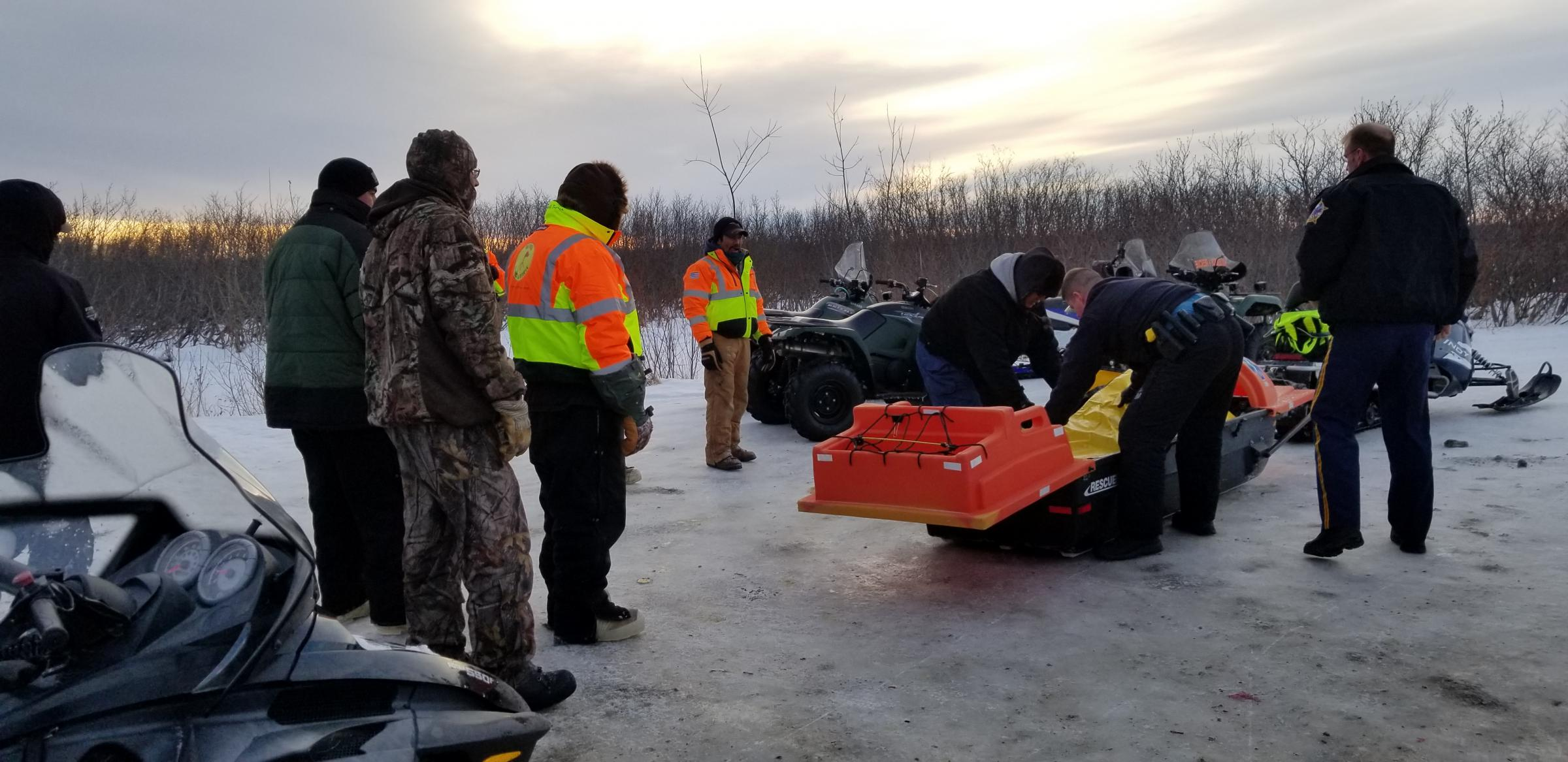 Bethel Search and Rescue releases Mark Kasayulie's body to the Alaska State Troopers on Jan. 1, 2018, near Bethel's Hangar Lake. (Photo courtesy Perry Barr/Bethel Search and Rescue)