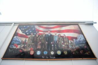 A new mural by Merrick Bochart hangs at American Legion Post 12 in Haines. (Photo by Berett Wilber/KHNS)