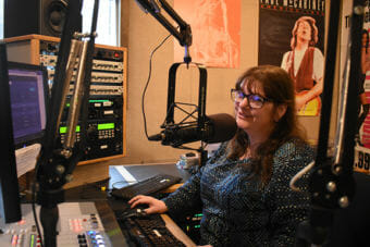 KSTK General Manager Cindy Sweat hosts morning programming for the Wrangell public radio station. (Photo by June Leffler/KSTK)