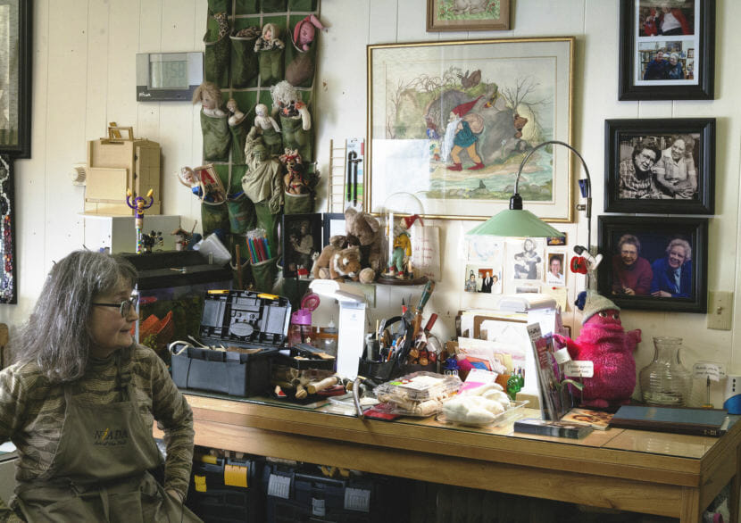 Mary Ellen Frank shows off her studio and work space at Aunt Claudia's Dolls museum in downtown Juneau. Frank creates custom dolls and owns an extensive collection of Alaskan Native doll art. (Photo by Tripp J Crouse/KTOO)