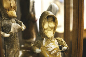 Yupik dolls with fish skin jackets are on display at Aunt Claudia's Dolls museum in downtown Juneau. (Photo by Tripp J Crouse/KTOO)