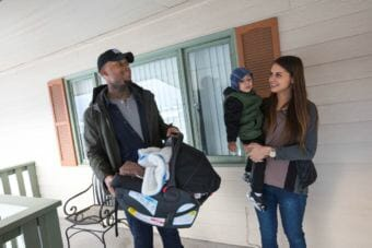 David Dumpson, left, holds newborn Kahleel, and fiancee Hannah Johnson, holds their 2-year-old son Kohen, as they check out an apartment in East Anchorage on Tuesday. (Photo Loren Holmes / ADN)