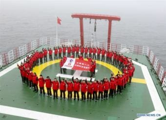 Scientists pose for team photo on the Chinese icebreaker Xuelong in 2017. (Photo by Xinhua/Yu Qiongyuan)