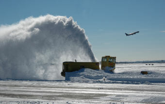 While mPing helps forecasters understand what's happening in the air, it's being used to study how surface transportation can be optimized during inclement weather. This is a snowblower at Boston Logan Airport. (Public domain photo by MassDOT)