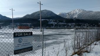 A sign notes that this 2.8-acre waterfront lot in Juneau is for sale on Feb. 14, 2018. The Alaska Mental Health Trust has listed it for sale since late 2016.