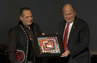 Sitka carver and educator Charlie Skultka Jr. receives the Margaret Nick Cooke Award for Alaska Arts and Languages from Gov. Bill Walker at the Governor's Arts and Humanities Awards gala in Juneau on Feb. 8, 2018.