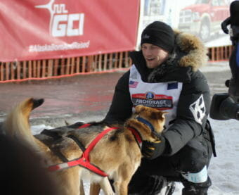 Defending Iditarod champion Dallas Seavey greets his leaders prior to the ceremonial start of Iditarod 2016. (Photo by Ben Matheson/Alaska Public Media.)