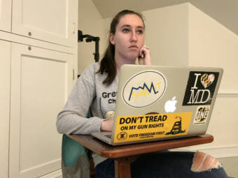 Jordan Riger, 22, uses her laptop to track attendance for a weekly meeting of Students for the Second Amendment at the University of Delaware in Newark, Del. She sees firearms as tools for self-defense. (Photo by Hansi Lo Wang/NPR)
