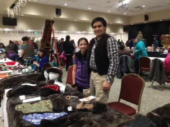 Marcus Gho poses with his daughter at his craft table at the Native Artists Market in November 2016. (Photo courtesy Marcus Gho)