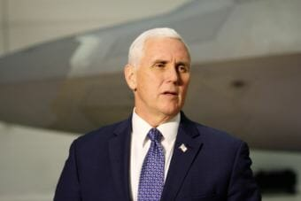 Vice President Mike Pence speaks in an airplane hangar Tuesday, February 6, 2018, at Joint Base Elmendorf-Richardson in Anchorage. (Photo by Emily Russell/Alaska Public Media)
