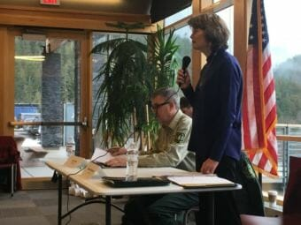 Sen. Lisa Murkowski speaks before a panel discussion about the Tongass National Forest Friday at the Ketchikan library. Seated is U.S. Forest Service Chief Tony Tooke. (Photo by Leila Kheiry/KRBD)