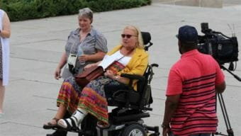 Kathy Hoell, second from left, joins another activist to advocate for disability rights at the state Capitol in Lincoln. Hoell helped Nebraska become a nationwide leader in voter access for people with disabilities. (Photo courtesy Kathy Hoell)