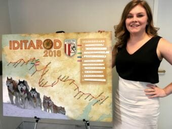 Devin O'Brien of Ketchikan poses with the Iditarod map outside of U.S. Sen. Lisa Murkowski's office in Washington, D.C., on March 12, 2018. O'Brien is one several staffers who updates the board.