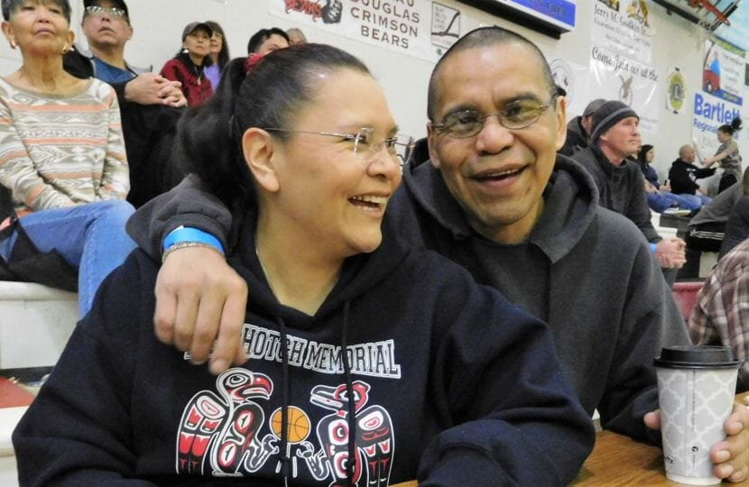 Siblings Marie and Thomas Beierly enjoy a moment during the Gold Medal Basketball Tournament, held March 18-24 in Juneau. Both are announcers during the games. (Photo by Ed Schoenfeld/CoastAlaska News)