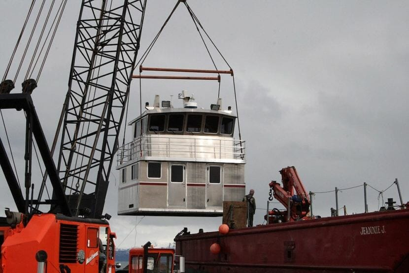 A crane moves an aluminum replacement cabin made by Homer's Bay Weld Boats. The company is one of a number of Alaska businesses already affected by President Trump's imported metals tariffs. (Photo courtesy Bay Weld Boats.)