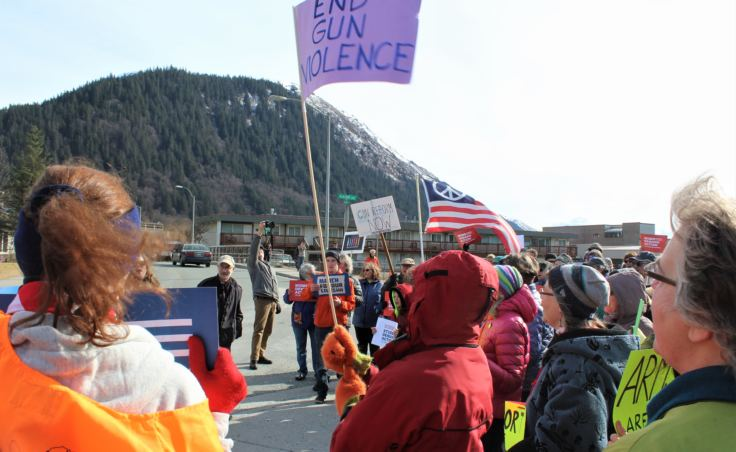 Protesters at Juneau's March for Our Lives gather outside the downtown offices of Sens. Lisa Murkowski and Dan Sullivan on March 24, 2018.