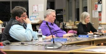 Juneau School Board members Dan DeBartolo, Emil Mackey and Andi Story prepare to vote on the district's Fiscal Year 2019 budget at a special meeting on March 27, 2018.
