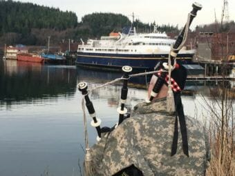 Rob Alley plays the bagpipes as a send off for the ferry Taku as the ship departs Ketchikan's Ward Cove on March 13, 2018.