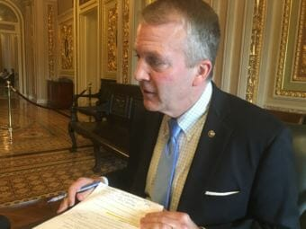 Sen. Dan Sullivan speaks to reporters in the Senate Reception Room. (Photo by Liz Ruskin/Alaska Public Media)