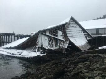 Around 3,000 gallons of oil were released into the Shuyak Strait after this building collapsed. (Photo courtesy U.S. Coast Guard)
