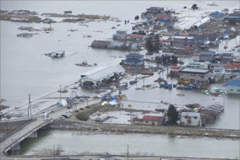 An aerial view of Ishinomaki, Japan, on March 18, 2011, one week after a devastating 9.0 magnitude earthquake and subsequent tsunami. LANCE CPL. ETHAN JOHNSON / U.S. MARINE CORPS.