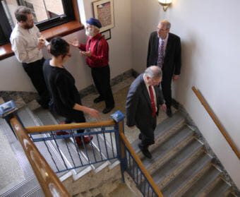 House Speaker Bryce Edgmon, D-Dillingham, front right, makes his way down from Senate Finance Co-Chair Lyman Hoffman's office to the Speaker's Chambers in the Alaska Capitol on April 25, 2018. He was on his way to a House Majority caucus meeting accompanied by his aide, Amory Lelake, and Rep. John Lincoln's aide Larry Persily. Reps. Lance Pruitt, R-Anchorage, and Paul Seaton, R-Homer, carry on a conversation in background. (Photo by Skip Gray/360 North)