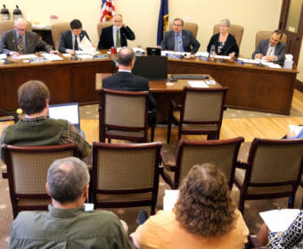 The legislative conference committee on the state operating budget bills meets in the Alaska Capitol on April 19, 2018. Members of the committee, from left to right, are Reps. Steve Thompson, R-Fairbanks, Neal Foster, D-Nome, Paul Seaton, R-Homer, and Sens. Lyman Hoffman, D-Bethel, Anna Mackinnon, R-Eagle River, and Donny Olson, D-Golovin. (Photo by Skip Gray/360 North)