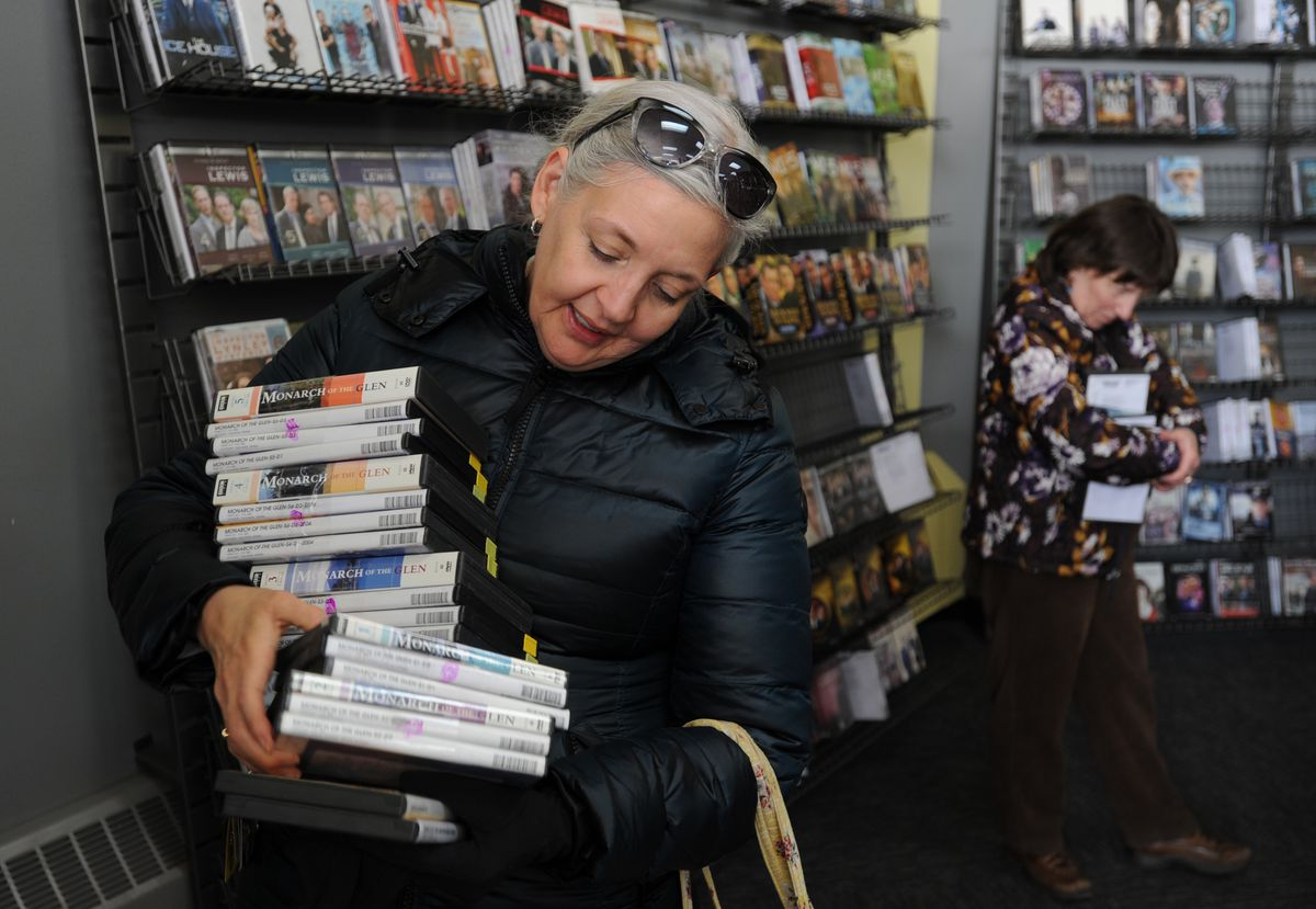 """Masha Hughton purchased the BBC series """"Monarch of the Glen,"""" which is based in Scotland, from the Blockbuster store at corner of Old Seward Highway and Huffman Road after it began selling its inventory on Tuesday. (Photo by Bill Roth/Anchorage Daily News)"""
