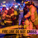 Capital City Fire/Rescue fights a fire in the 200 block of North Franklin Street on the evening of Monday, April 16, 2018. (Photo by Mikko Wilson/KTOO)