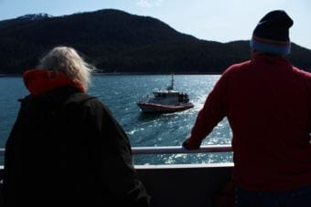Volunteers watch as a U.S. Coast Guard vessel approaches the St. Nicholas during a training exercise. (Photo by Adelyn Baxter/KTOO)