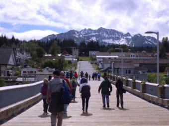 Tourists walk on the cruise ship dock towards Haines' Fort Seward. (Photo by Emily Files/KHNS)
