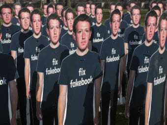 Cardboard cutouts of Facebook founder and CEO Mark Zuckerberg stand outside the U.S. Capitol in Washington as he testified before a Senate panel last week. (Photo by Kevin Wolf/Associated Press)