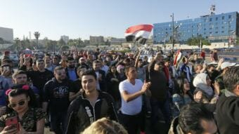 Syrians condemn the U.S.-led airstrikes, at a protest Saturday at the Omayyad Square in Damascus. (Photo by Louai Beshara/AFP/Getty Images)