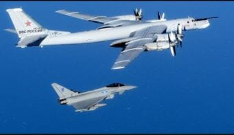 A Russian Tu-95 Bomber being escorted by British forces in 2014. (Photo courtesy U.K. Ministry of Defence)