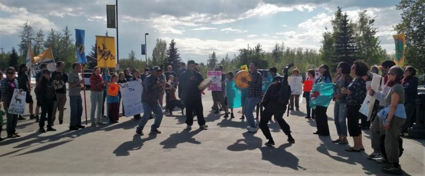 Athabascan drummers Travis Cole, Sunny Luke and Norman Carlo lead protesters to the Carlson Center in Fairbanks on Tuesday, May 29, 2018. The Bureau of Land Management was meeting on the federal plan to lease portions of the ANWR coastal plain for oil and gas development.