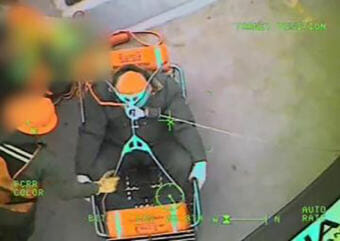 An Air Station Sitka helicopter man hoists a 61-year-old tugboat captain from the Maia H in Chatham Strait. The man was experiencing stroke symptoms and was medevaced to Sitka. (Video still courtesy U.S. Coast Guard)
