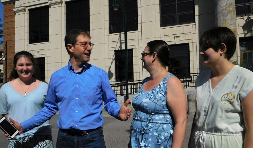 Juneau Democrat Jesse Kiehl announces his run for the state Senate seat being vacated by Dennis Egan Thursday near the Capitol. Nonpartisan candidate Don Etheridge recently announced he's running for the same Senate seat. (Photo by Ed Schoenfeld/CoastAlaska News)