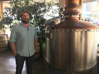Amalga Distillery co-owner Brandon Howard opposes a proposal to reduce the amount breweries and distilleries can sell as samples. His Juneau business has benefited from the sales. (Photo by Andrew Kitchenman/KTOO)