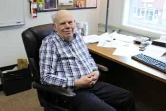 Director of Administrative Services David Means sits in his office. Means will retire at the end of June after 13 years with the Juneau School District. (Photo by Adelyn Baxter/KTOO)
