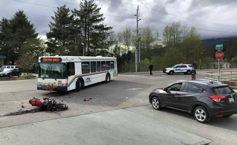 Officers with the Juneau Police Department block off traffic along Glacier Highway on Saturday, May 12, 2018 after a collision between a Capital Transit bus and a motorcycle. (Photo by David Purdy/KTOO)