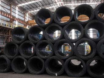 Coils of steel wire sit stacked in the shipping area of the Grupo Acerero SA steel processing facility in San Luis Potosi, Mexico, on March 6. (Photo by Bloomberg via Getty Images)