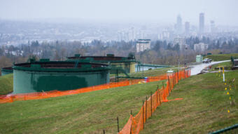 The Canadian government is buying a pipeline expansion project in an effort to eliminate further derailment from protests and delays. Here, oil tanks stand near the Trans Mountain pipeline expansion site in Burnaby, British Columbia, in April. (Photo by Bloomberg via Getty Images)