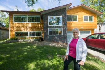 Former Alaska state legislator Alyce Hanley poses outside the apartment she had built into the bottom floor of her home in Sand Lake on Thursday, June 7, 2018. Hanley, who is 84, wanted to live with her children but have her own living space. (Loren Holmes/ADN)