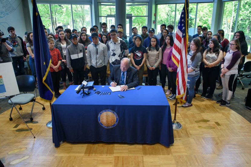 Gov. Bill Walker signs Senate Bill 26, House Bill 286, House Bill 285, and Senate Bill 142 in the ANSEP building on the UAA campus in Anchorage, on June 13, 2018. The suite of bills cover permanent fund draws and the operating, mental health and capital budgets for fiscal year 2019.
